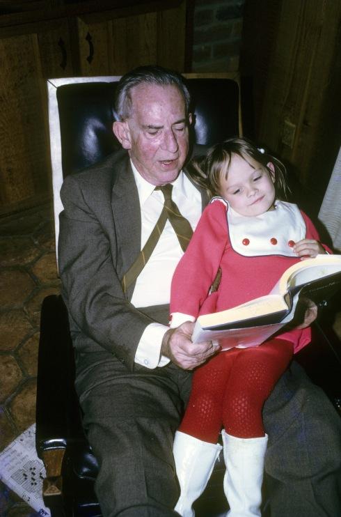 Pop Sprinkle reading to his great-granddaughter Renee