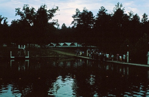 The lower lake with swimming areas marked by buoys. The cafeteria is in the background.