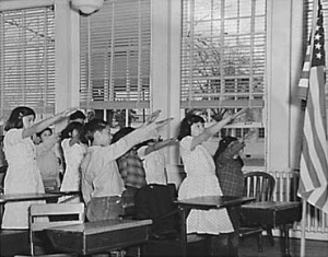 Students_pledging_allegiance_to_the_American_flag_with_the_Bellamy_salute